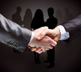 Close-up of business people shaking hands to confirm their partnership — Stock Photo