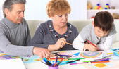 Grandmother, grandfather and grandson spend time together. Symbol of the family. — Stock Photo