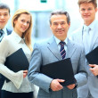 Group portrait of a professional business team looking confidently at camera — Stock Photo #41303593