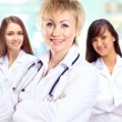 Portrait of group of smiling hospital colleagues standing together — Stock Photo #42046747