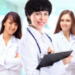 Portrait of group of smiling hospital colleagues standing together — Stock Photo #42046761