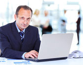 Man working at the office on laptop — Stock Photo