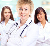 Portrait of group of smiling hospital colleagues standing together — Stock Photo