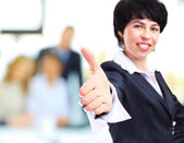 Business woman with hand extended to handshake — Stock Photo