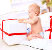 Photo of cute girl with gift — Stock Photo