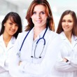 Portrait of group of smiling hospital colleagues standing together — Stock Photo #43821893