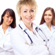Portrait of group of smiling hospital colleagues standing together — Stock Photo #43821903