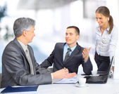 A business team sitting in office and planning work — Stock Photo