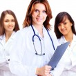 Portrait of group of smiling hospital colleagues standing together — Stock Photo #45579695