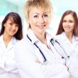 Portrait of group of smiling hospital colleagues standing together — Stock Photo #45579799