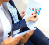 Close-up of graphs and charts analyzed by business people — Stock Photo