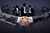 Close-up of business people shaking hands to confirm their partnership — Stok fotoğraf