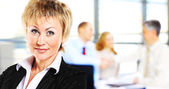 Image of pretty businesswoman looking at camera — Stock Photo