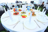 Catering table set service with silverware and glass stemware at restaurant before party — Stock Photo