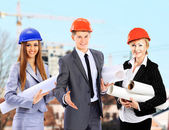 Group of builders workers. Construction industry background. — Stock Photo
