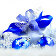 Festive balls with gift box on snow — Stock Photo #8134493