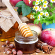 Full honey pot and honey stick — Stock Photo