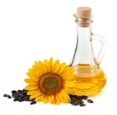 Sunflower oil with flower and seeds — Stock Photo