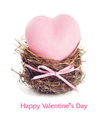 Pink heart in the nest. — Stock Photo