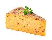Piece of cheese with spices — Stock Photo