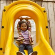Stock Photo: Child playing on a slide