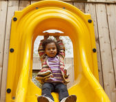 Child playing on a slide — Stock Photo