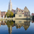 Old town and church in Brugge — Stock Photo #12610075