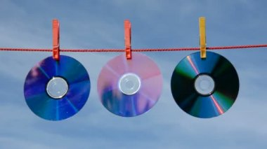 Dvd and cd discs on string and wind — Stock Video