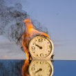 Burning clock dial - time symbol — Stock Photo