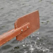 Stock Video: Brown wooden boat oar and water