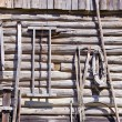 Ancient wooden etnographic barn wall with tools — Stock Photo