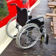 Empty invalids wheelchair in sea beach cafe — Stock Photo #13495970