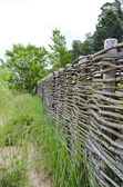 Old wicker fence in resort park — Stock Photo