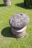 Stone and millstone in farm — Stock Photo