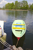 Plastic boat on resort lake — Stock Photo