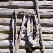 Old barn wall with vintage agriculture tools — Stock Photo