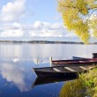 Autumn lake lasndscape with boats — Stock Photo