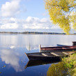 Autumn lake lasndscape with boats - Stock Photo