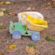 Stock Photo: Abandoned plastic truck toy in autumn sand box