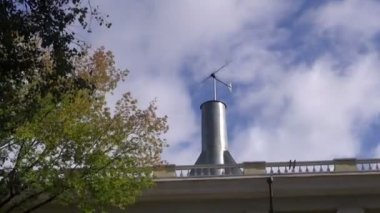 Windmill on house roof — Stock Video