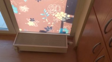 Modern heating radiator in new house room — Vídeo Stock