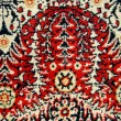 Ancient ornamental carpet background — Stock Photo