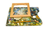 Painters palette with brush and canvas frame on white — Stock Photo