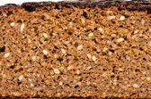 穀物と茶色の生態学的なパンのスライス — ストック写真