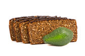 Brown bread with grains slice and avocado on white — 图库照片