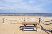 Summer sea beach with ropes fence — Stock fotografie