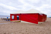 Red summer resort cafe tent on sea beach — Stock Photo