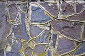 Pęknięty i starego kamiennego muru tło — Zdjęcie stockowe