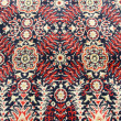 Stock Photo: Ancient ornamental carpet background
