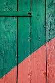 Red and green painted door background — Stock Photo